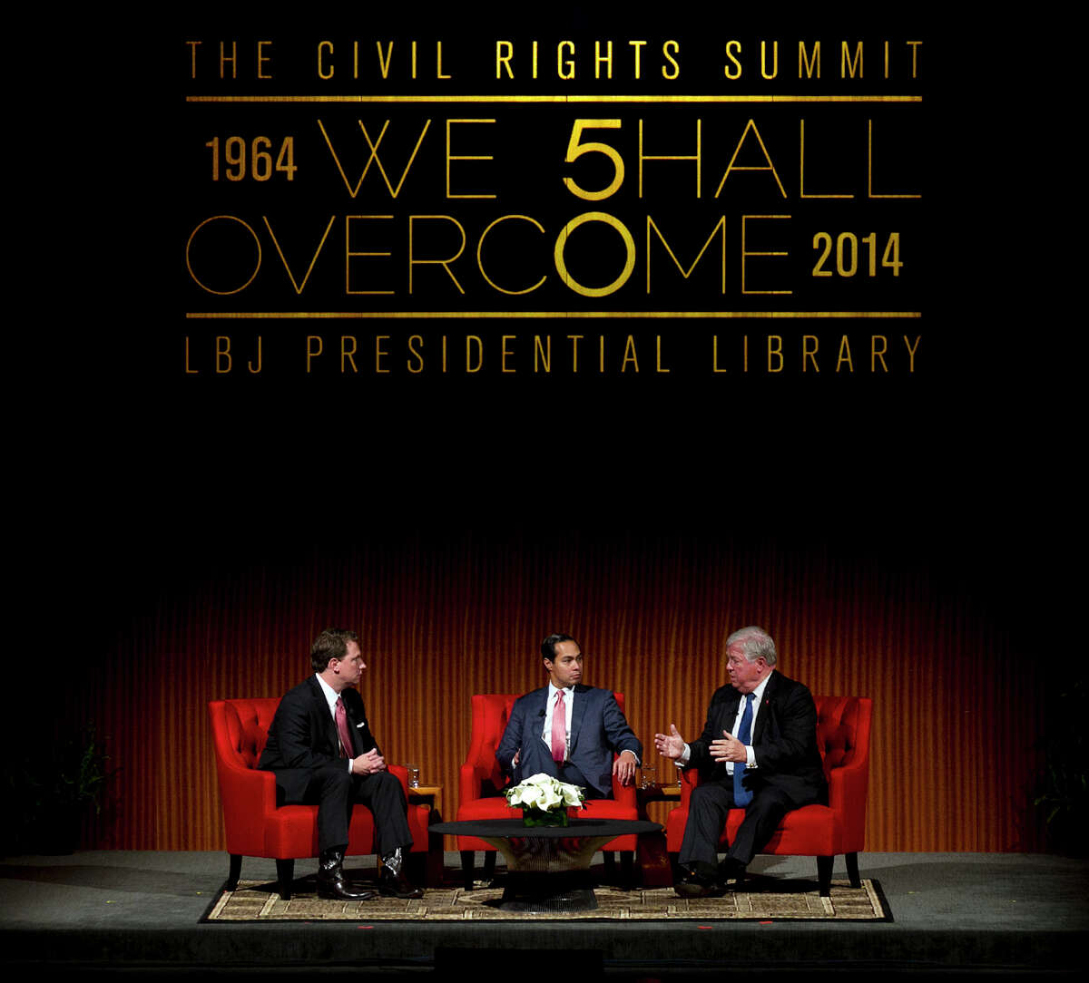 From left, Moderator Brian Sweany, Senior Executive Editor at Texas Monthly, left, and Mayor of San Antonio, Julian Castro, center, listens to former Governor of Mississippi, Haley Barbour, during the 'Pathway to the American Dream: Immigration Policy in the 21st Century' panel at the Civil Rights Summit at the LBJ Presidential Library on the University of Texas campus in Austin, Tx., on Tuesday, April 8, 2014.