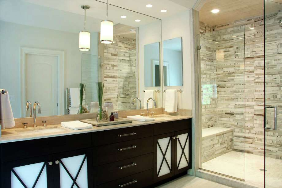 Soaking tubs, heated floors, shower lighting and steam showers are popular items for today's bathrooms, according to the 2014 National Kitchen & Bath Association Design Trends Survey. Photo: Contributed Photo, Contributed / New Canaan News