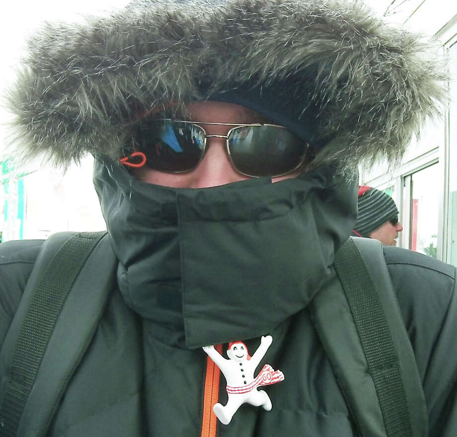 Daniel Kotas shlelds himself from the cold at Carnaval during a trip by 19 Shepaug Valley Middle/High School students to Quebec, Canada in February 2014  Courtesy of Heidi Edel Photo: Contributed Photo / The News-Times Contributed