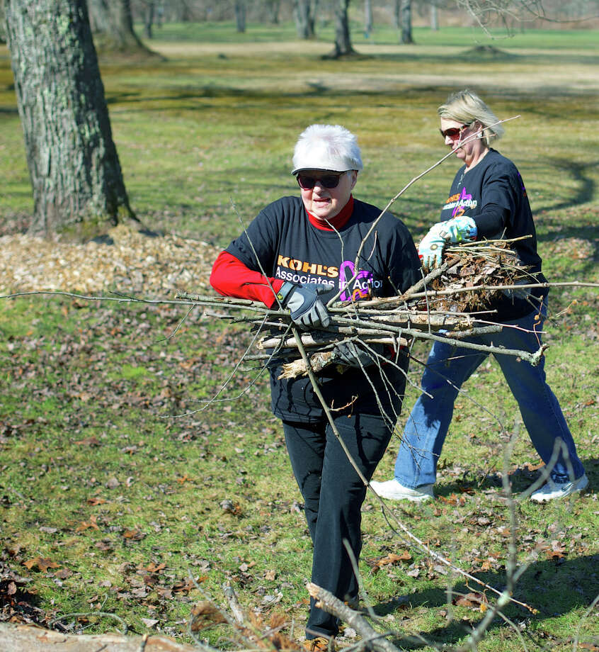 """Among the energetic representatives of the """"Kohl's Cares"""" volunteer team are Carol Schroeder, left, and Carol Schmitt of New Milford during an April 12, 2014 volunteer cleanup day hosted by the Friends of Harrybrooke Park in New Milford. Photo: Trish Haldin / The News-Times Freelance"""