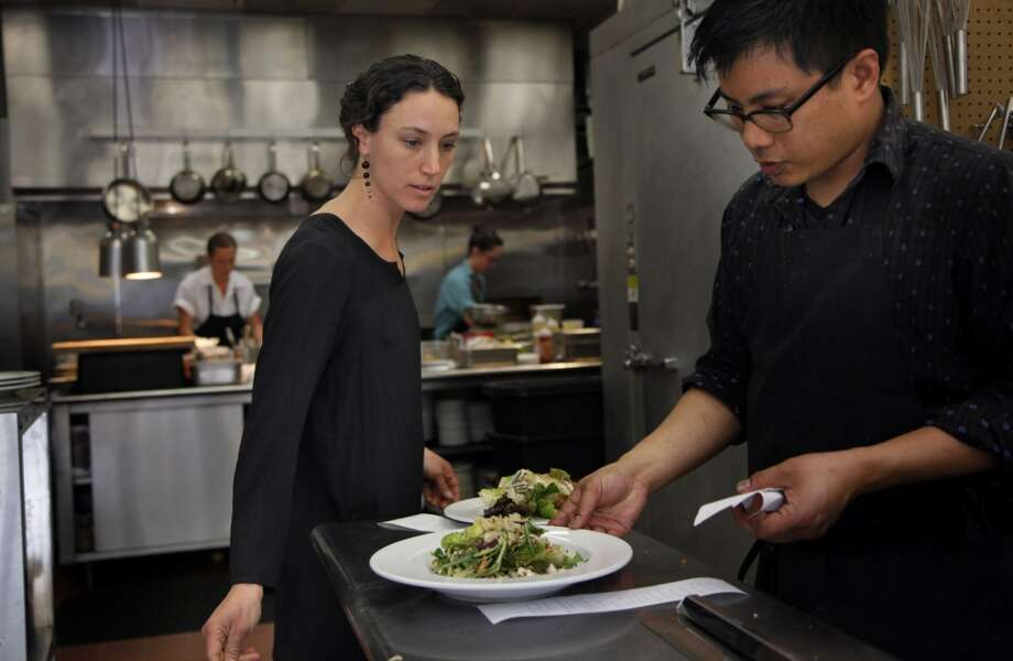 Kendra Baker recently opened Assembly, billed as the area's top fine-dining destination. She works in the kitchen with chef Carlo Espinas in Santa Cruz, Calif., on Thursday, April 10, 2014. Photo: Special To The Chronicle
