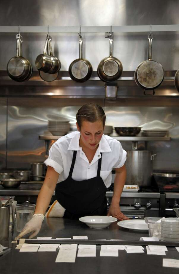 Line cook Jenna Freshour manages the lunch rush at Assembly, billed as the area's top fine-dining destination, in Santa Cruz, Calif., on Thursday, April 10, 2014. Photo: Special To The Chronicle