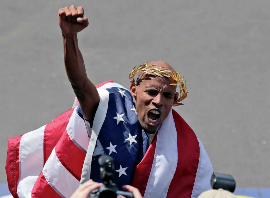 Meb Keflezighi, of San Diego, Calif., celebrates his victory in the 118th Boston Marathon Monday, April 21, 2014 in Boston. (AP Photo/Charles Krupa) Photo: Charles Krupa, Associated Press / AP