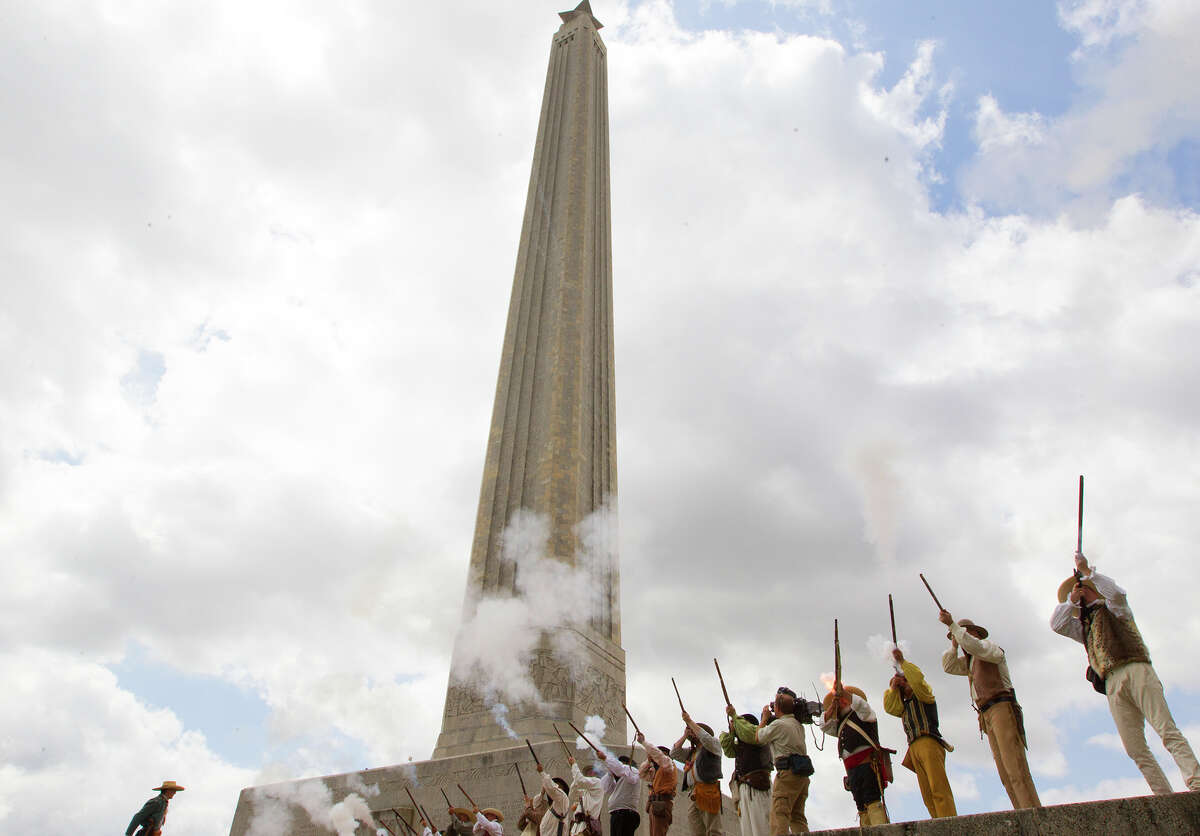 A group of reenactors fire honorary shots in front of the San Jacinto Monument during a ceremony in honor of San Jacinto Day, Monday, April 21, 2014, in La Porte. The battle of San Jacinto took place 178 years ago against Mexican troops. Sam Houston led the battle that ultimately led to Texas' independence.