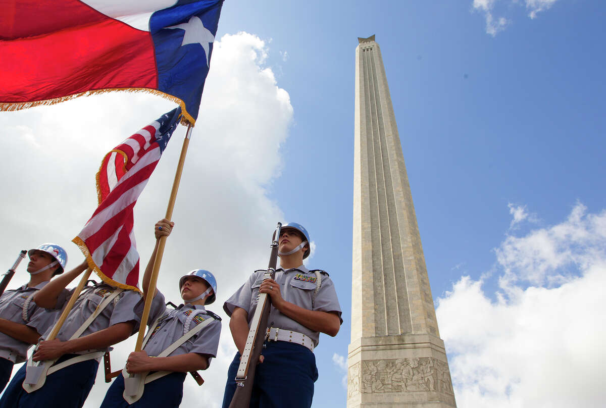 Deer Park High School ROTC cadets, from left to right, Corporal Kyle Hiarker, Second Lieutenant Jorge Chapa, First Lieutenant Donald DuPont, and Staff Sergeant Jared Jeffries, present the colors in front of the San Jacinto Monument during a ceremony in honor of San Jacinto Day, Monday, April 21, 2014, in La Porte. The battle of San Jacinto took place 178 years ago against Mexican troops. Sam Houston led the battle that ultimately led to Texas' independence.
