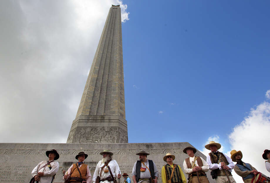A group of reenactors stand in front of the San Jacinto Monument during a ceremony in honor of San Jacinto Day, Monday, April 21, 2014, in La Porte. The battle of San Jacinto took place 178 years ago against Mexican troops. Sam Houston led the battle that ultimately led to Texas' independence. Photo: Cody Duty, Houston Chronicle / © 2014 Houston Chronicle