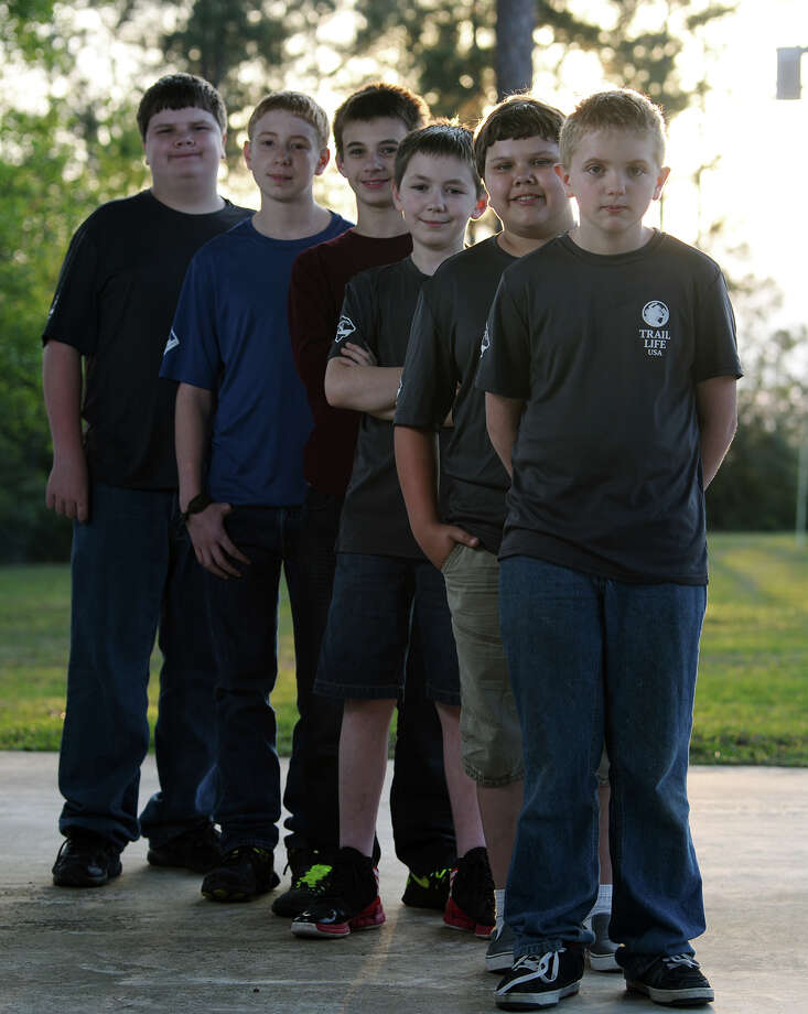 Trail Life USA Troop 316 -- Keith Hastings, 12, Kyle Bane, 12, Brady Freeman, 11, Bailey Thornton, 13, Brayden McKee, 14, and Corbin Bane, 14, front to back -- pose for a picture Thursday afternoon. The troop meets regularly on Monday nights at Wildwood Village Mills United Methodist Church. Photo taken Thursday, 4/17/14 Jake Daniels/@JakeD_in_SETX Photo: Jake Daniels / ©2014 The Beaumont Enterprise/Jake Daniels