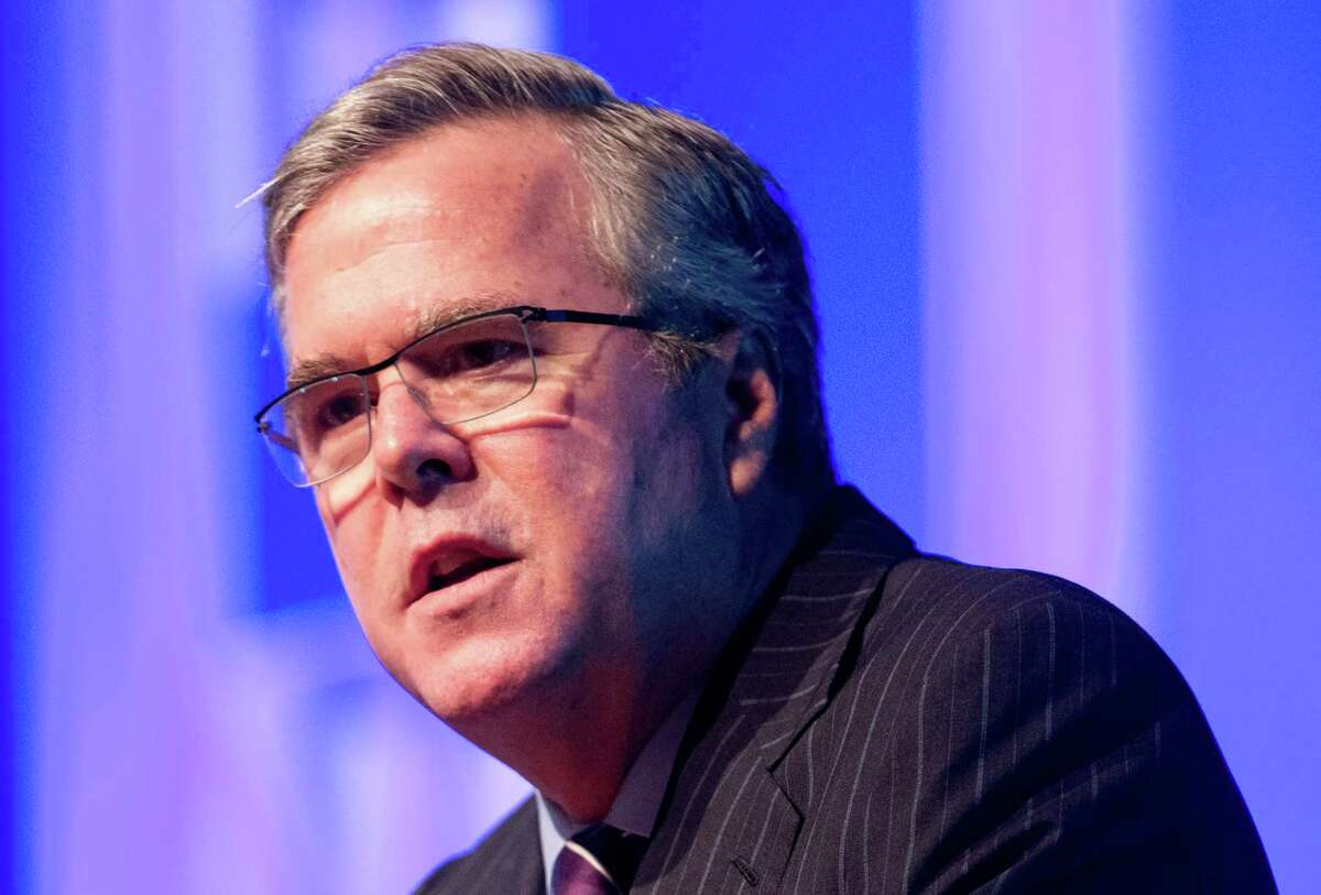 """This Jan. 29 file photo shows former Florida Gov. Jeb Bush speaking in Hollywood, Fla. With three little words, Bush recently set off a fury that served as a potent reminder of how difficult the immigration issue remains for the potential presidential contender and the GOP. The Republican establishment's preferred White House hopeful described illegal immigration as an """"act of love"""" by people hoping to provide for their families. (AP Photo/Wilfredo Lee, File)"""