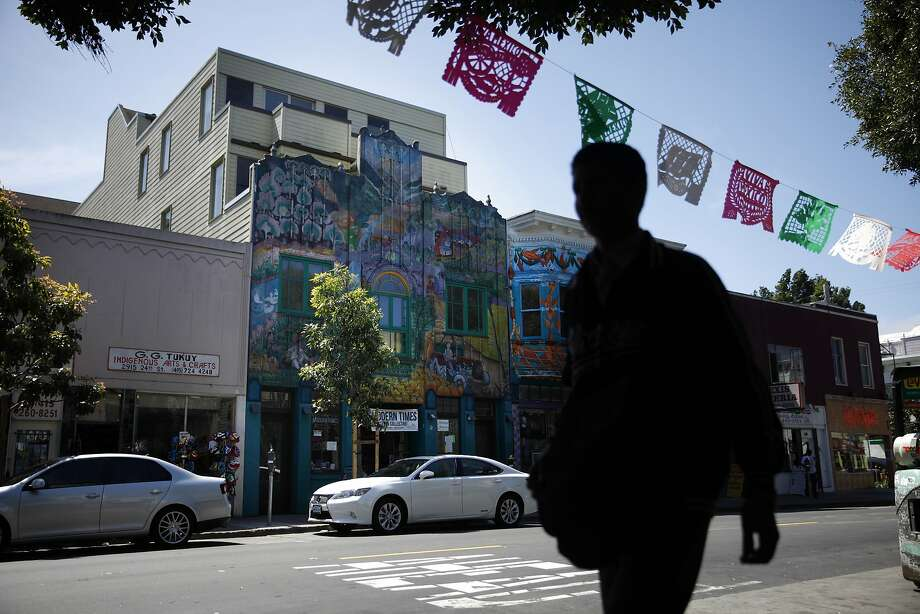 Condos (second from left)  are seen behind a facade that was saved along with the mural on it along 24th Street on Thursday, April 17, 2014 in San Francisco, Calif. Photo: Lea Suzuki, The Chronicle