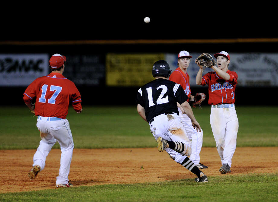 Vidor's Dalton Croft, No. 12, is caught between Lumberton's Joe Hancock, No. 17, and Josh Terry, No. 3, during a game earlier this season. Vidor hosts Humble Kingwood Park in a best-of-three series which will be home-and-home for tonight and tomorrow.   Jake Daniels/@JakeD_in_SETX Photo: Jake Daniels / ©2014 The Beaumont Enterprise/Jake Daniels