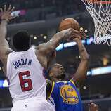 Apr 19, 2014; Los Angeles, CA, USA; Los Angeles Clippers center DeAndre Jordan (6) defends a shot by Golden State Warriors forward Harrison Barnes (40) in the first half in game one during the first round of the 2014 NBA Playoffs at Staples Center. Mandatory Credit: Jayne Kamin-Oncea-USA TODAY Sports