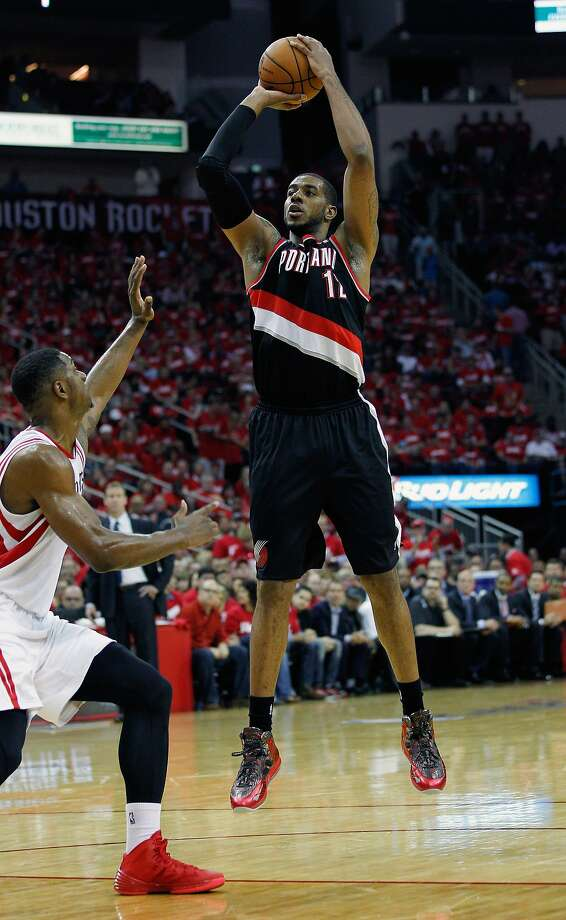 HOUSTON, TX - APRIL 20:  LaMarcus Aldridge #12 of the Portland Trail Blazers shoots over Terrence Jones #6 of the Houston Rockets in Game One of the Western Conference Quarterfinals during the 2014 NBA Playoffs at the Toyota Center on April 20, 2014 in Houston, Texas. NOTE TO USER: User expressly acknowledges and agrees that, by downloading and or using this photograph, User is consenting to the terms and conditions of the Getty Images License Agreement.  (Photo by Bob Levey/Getty Images) Photo: Bob Levey, Getty Images
