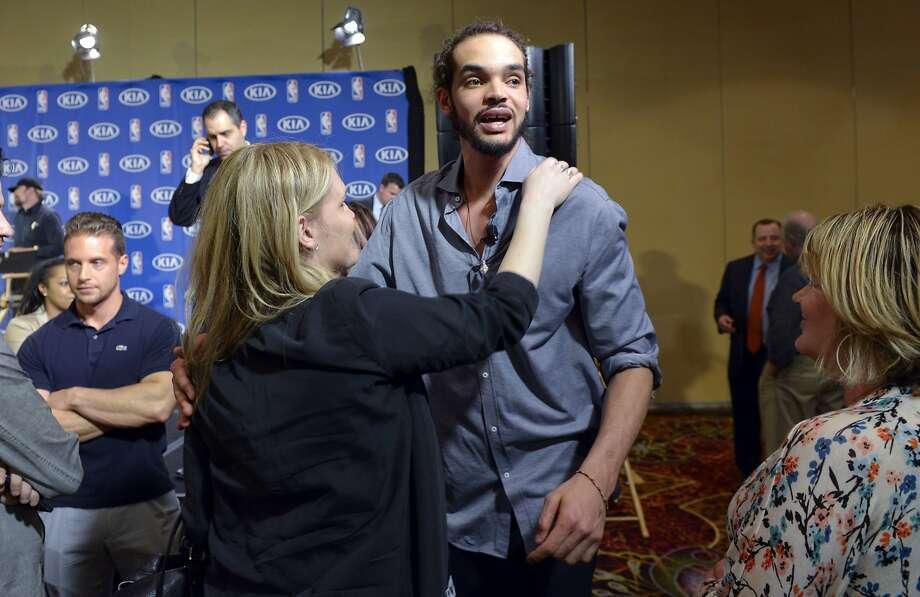 Chicago Bulls center Joakim Noah celebrates with family after being awarded the NBA's Defensive Player of the Year honor, Monday, April 21, 2014, in Lincolnshire, Ill. (AP Photo/Matt Marton) Photo: Matt Marton, Associated Press