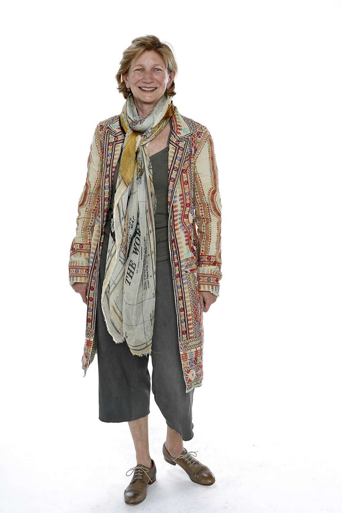 Penelope Finnie, a painter who lives in Berkeley, also owns three Bittersweet chocolate cafes. She wears a Two Ten Ten Five coat, Faliero Sarti scarf and Mayer Peace Collection pants.