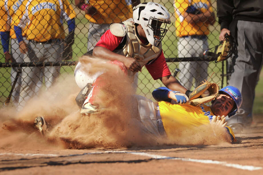 Harding's Alex Cardosa slides safely into home ahead of the tag of Central catcher Ricardo Greene in the opening inning of their FCIAC baseball game at Beardsley Park in Bridgeport, Conn. on Monday, April 21, 2014. Photo: Brian A. Pounds / Connecticut Post