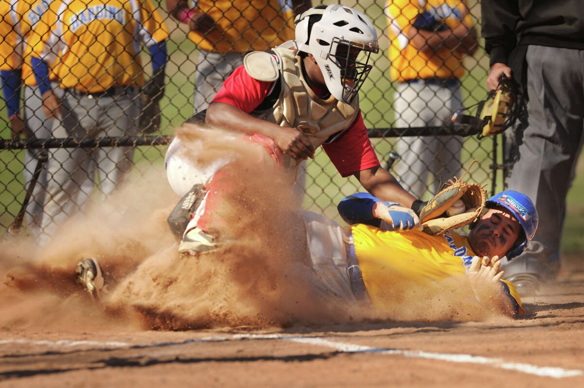 Harding's Alex Cardosa slides safely into home ahead of the tag of Central catcher Ricardo Greene in the opening inning of their FCIAC baseball game at Beardsley Park in Bridgeport, Conn. on Monday, April 21, 2014.