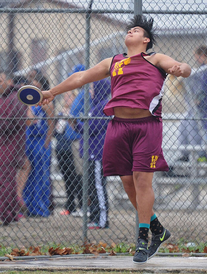 Andres Garcia of Harlandale hurls the discus at the District 29/30-4A meet April 16 at Gregory-Portland. He won second with a 152-9 distance. He also took first in the shot put with 54-6. Both of those distances are season-bests for Garcia. Photo: Courtesy Photo
