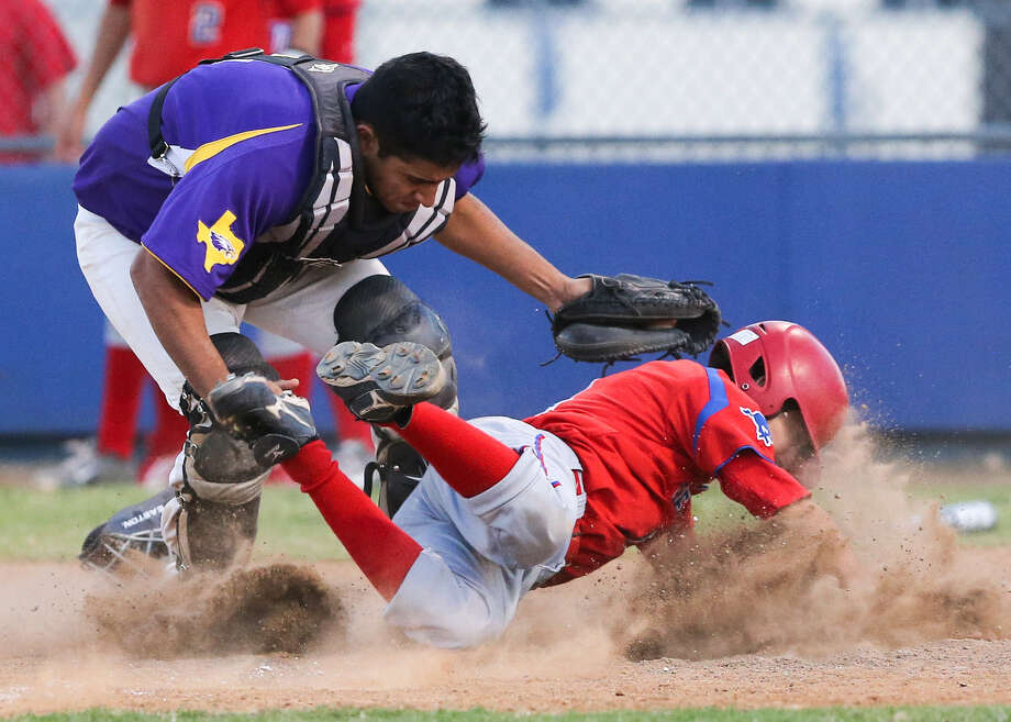Brackenridge catcher Tristen Cortinas, left, tags Jefferson's Orlando Rodriguez out as he slides into home plate during their April 15 game at the SAISD Sports Complex. Photo: Marvin Pfeiffer / Southside Reporter / Express-News 2014