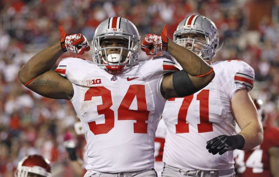 Carlos Hyde, 6-0, 230, 4.66, Ohio StateHyde captures the uncertainty of the 2014 draft class at running back. The 2013 Big Ten back of the year missed the first three games of Ohio State's season due to an assault investigation. A disappointing NFL scouting combine didn't help Hyde's case. But he's still the best talent in a weak backfield class. Photo: Sam Riche, Associated Press