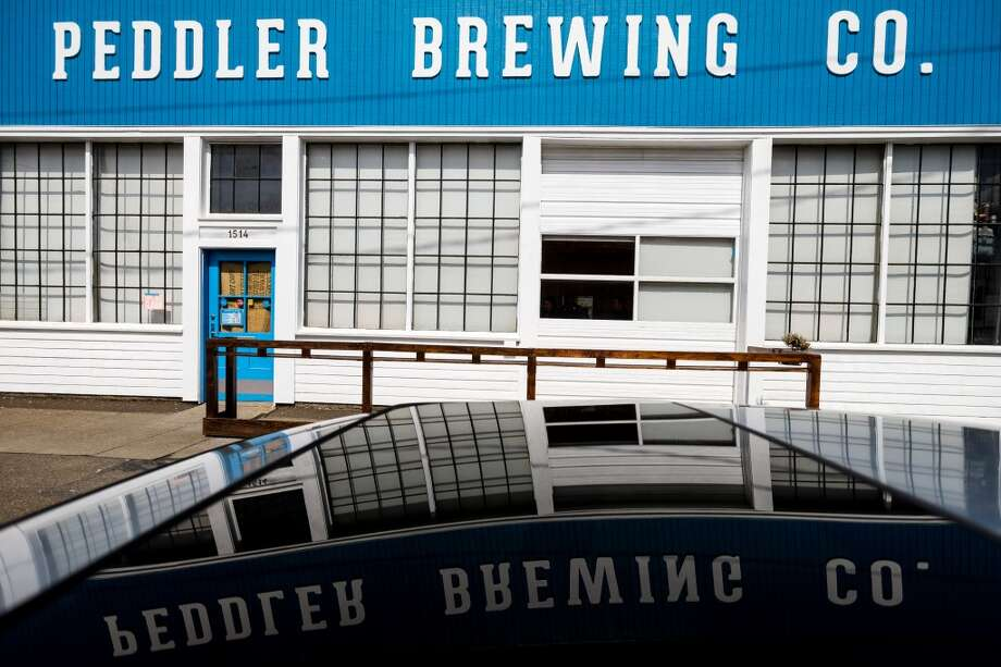 Peddler Brewing Co., 1514 NW Leary Way, Ballard:Just off Leary and 15th in Ballard, Peddler debuted in March 2013, opened by cycling enthusiasts (hence the name). The microbrewery pumps out 14 kegs per batch and offers 12 beverages on tap at a time, including some regulars, a few seasonals and a guest cider. The tasting room also offers a refuge for cyclists with indoor bike racks and a bicycle work station. See if you can play cornhole while holding your kolsch. Photo: JORDAN STEAD, SEATTLEPI.COM