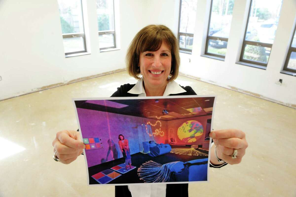 Owner, Sheri Townsend holds a photograph of what the serenity room will look like when completed at the Bizzy Beez Activity Center on Monday, April 21, 2014, in Colonie, N.Y. The serenity room will be a multi-sensory activity room to help children become more centered and focused. The building when finished will be the new location of the Spotted Zebra Learning Center and the Bizzy Beez Activity Center. (Paul Buckowski / Times Union)