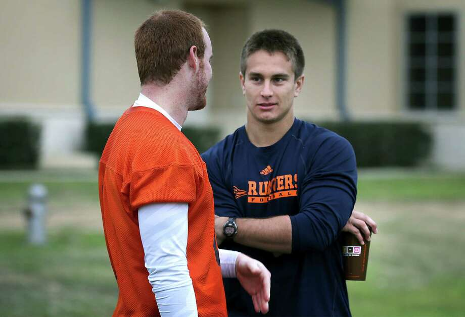 Eric Soza, right, UTSA quarterback from last year, talks to Tucker Carter, who will be a quarterback this year.  Wednesday, March 26, 2014. Photo: San Antonio Express-News / © 2012 San Antonio Express-News