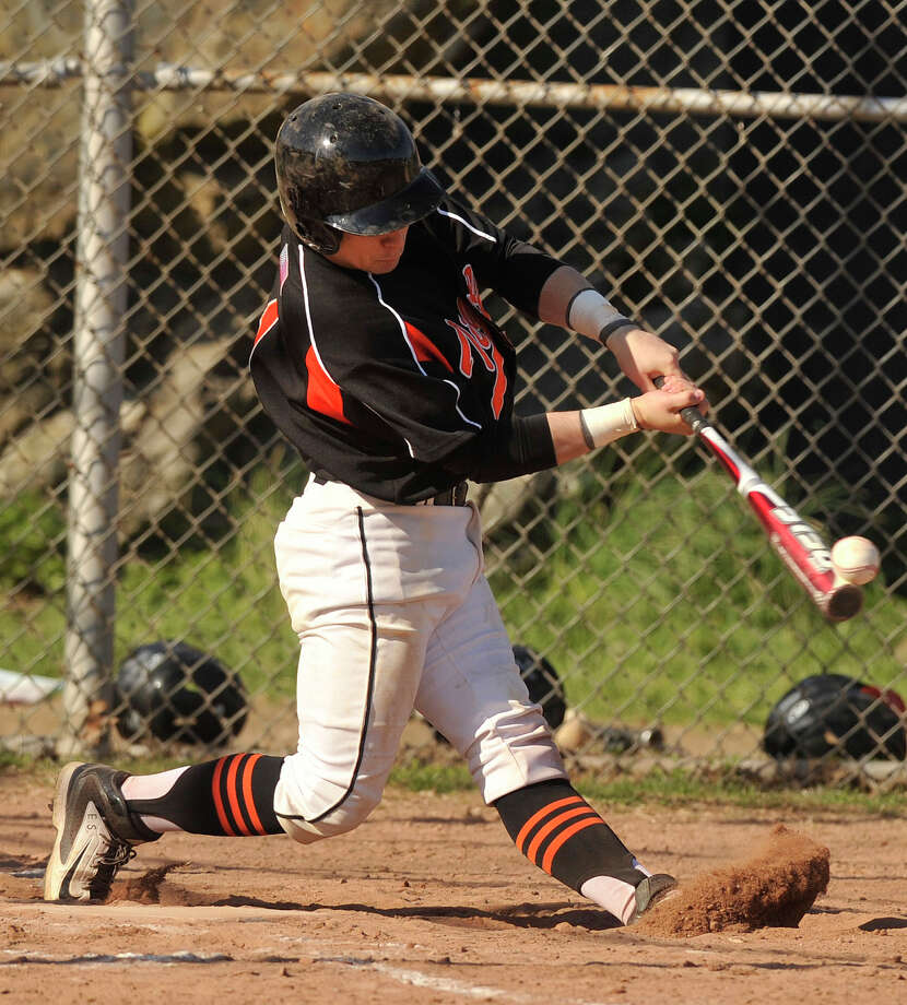 Ridgefield's John Boscia connects with the ball during their baseball game at Stamford High School in Stamford, Conn., on Monday, April 21, 2014. Ridgefield won, 7-4. Photo: Jason Rearick / Stamford Advocate