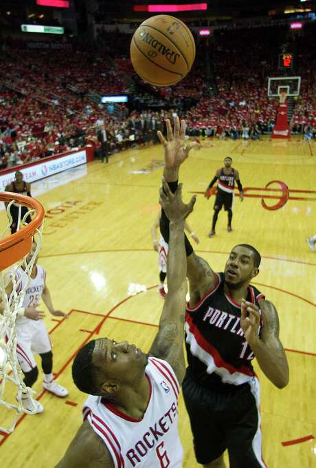 Rockets coach Kevin McHale admits not having an answer for LaMarcus Aldridge, right, but he has a name, calling the Blazers forward who had 46 points Sunday a runaway train. Photo: Brett Coomer, Staff / © 2014 Houston Chronicle