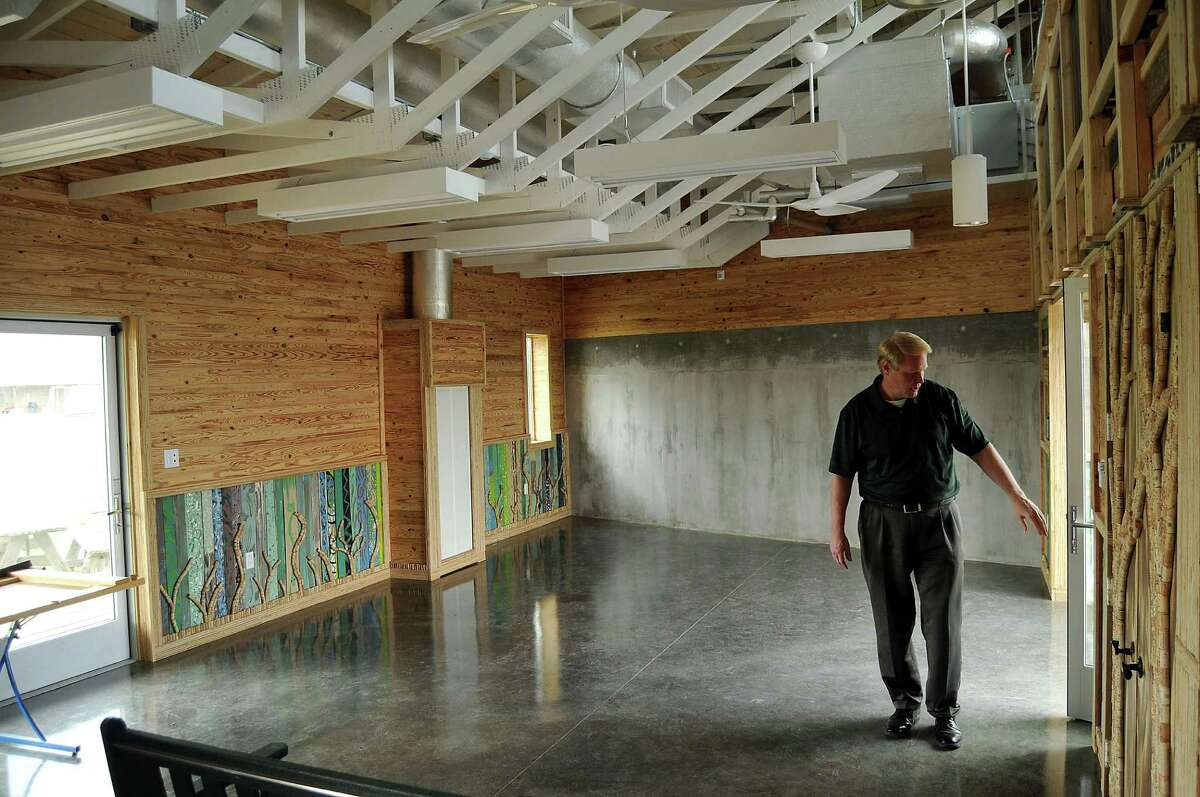 """Russell Hubbard, Monarch School communications director, tours the """"Living Building"""" classroom, which aims to produce the energy it uses - a goal students are tasked with ensuring."""