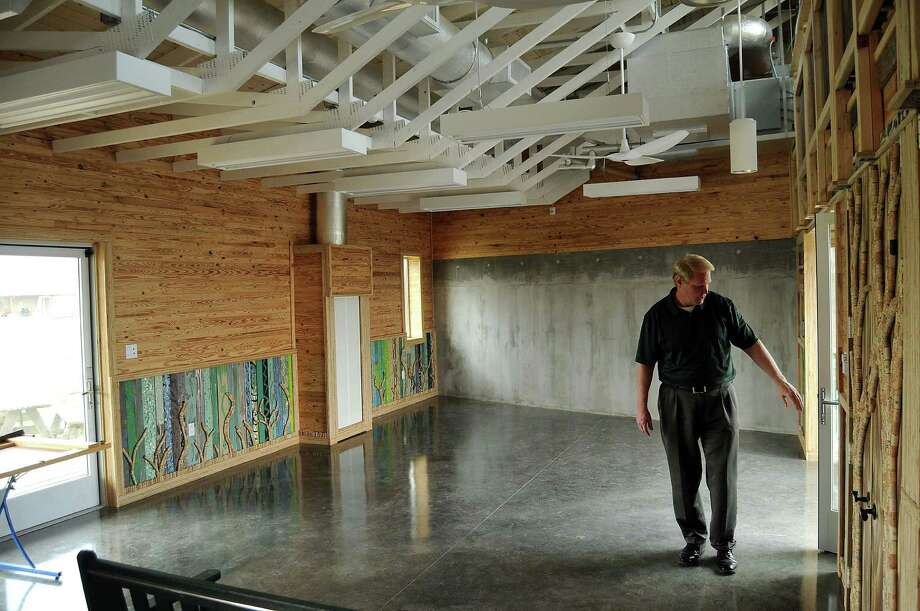 "Russell Hubbard, Monarch School communications director, tours the ""Living Building"" classroom, which aims to produce the energy it uses - a goal students are tasked with ensuring. Photo: Dave Rossman, Freelance / Freelance"