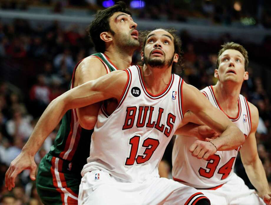 FILE - In this April 4, 2014 file photo, Chicago Bulls center Joakim Noah (13) defends against Milwaukee Bucks center Zaza Pachulia during an NBA basketball game in Chicago.  A person familiar with the situation says that Noah is the NBA's Defensive Player of the Year. The person spoke Monday, April 21, 2014 on the condition of anonymity because the award had not been announced. (AP Photo/Kamil Krzaczynski, File) ORG XMIT: CX107 Photo: Kamil Krzaczynski / FR136454 AP
