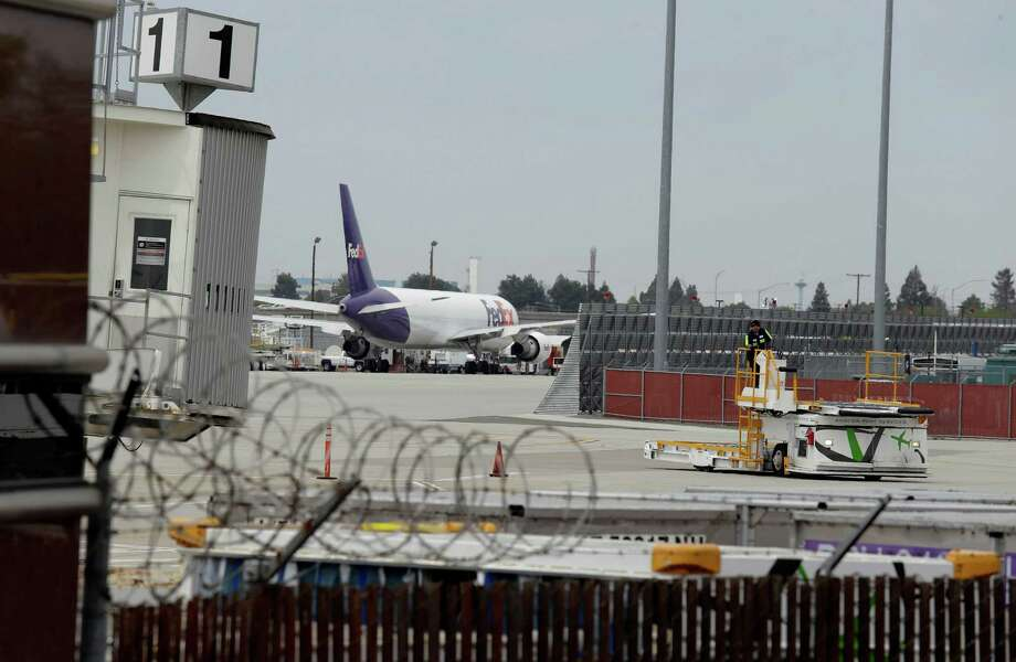 A worker moves equipment near gates used by Hawaiian Airlines at Terminal A of Mineta San Jose International Airport in April. Photo: Eric Risberg / Associated Press / AP