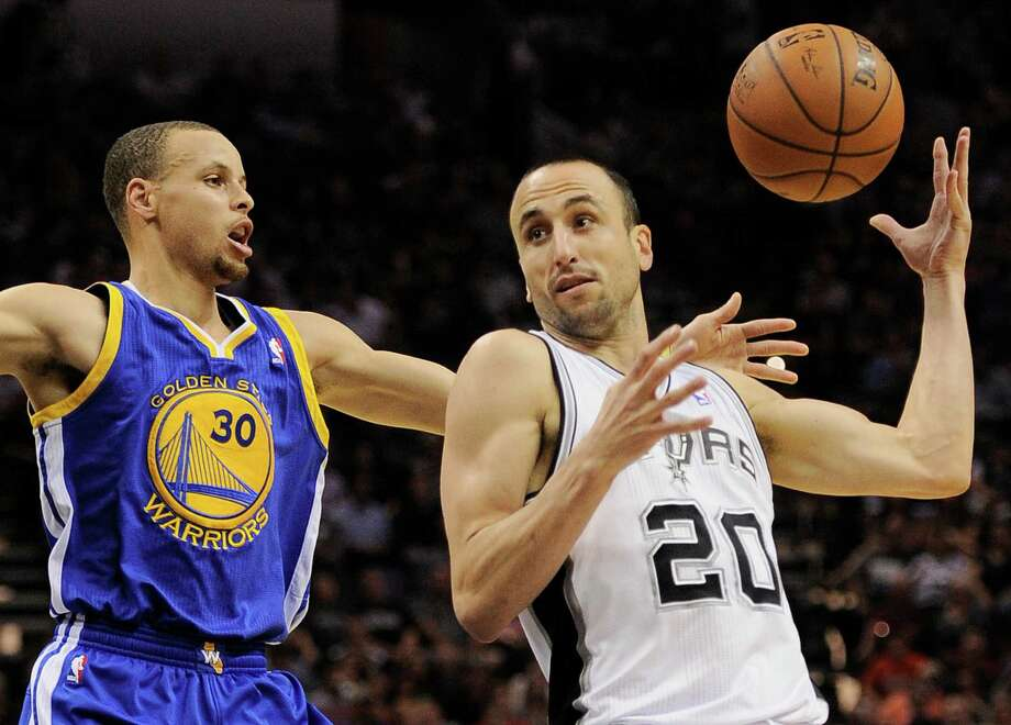 San Antonio Spurs guard Manu Ginobili, right, of Argentina, drives around Golden State Warriors guard Stephen Curry during the first half of an NBA basketball game on Wednesday, April 2, 2014, in San Antonio. (AP Photo/Darren Abate) Photo: Darren Abate, Associated Press / FR115 AP