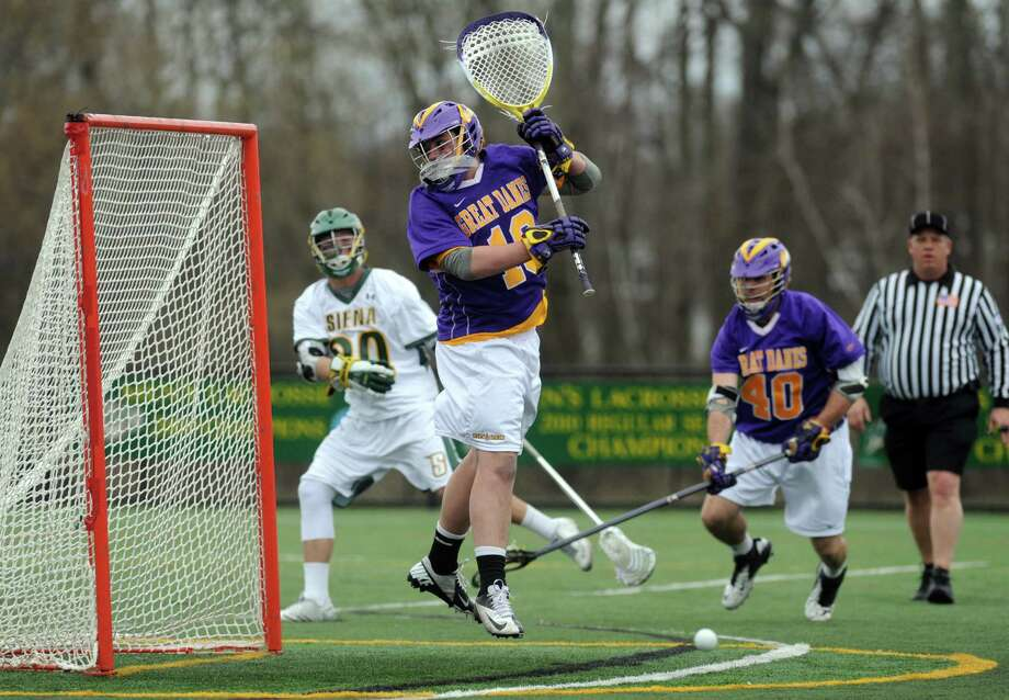 UAlbany's goalie Blaze Riorden looks for the ball after a save during their men's college lacrosse game against Siena on Tuesday April 23, 2013 in Loudonville, N.Y.(Michael P. Farrell/Times Union) Photo: Michael P. Farrell / 10022067A