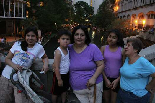 Many San Antonians lined the River Walk for the Texas Cavalier River Parade on Monday. Photo: Jacob Beltran, For MySA.com