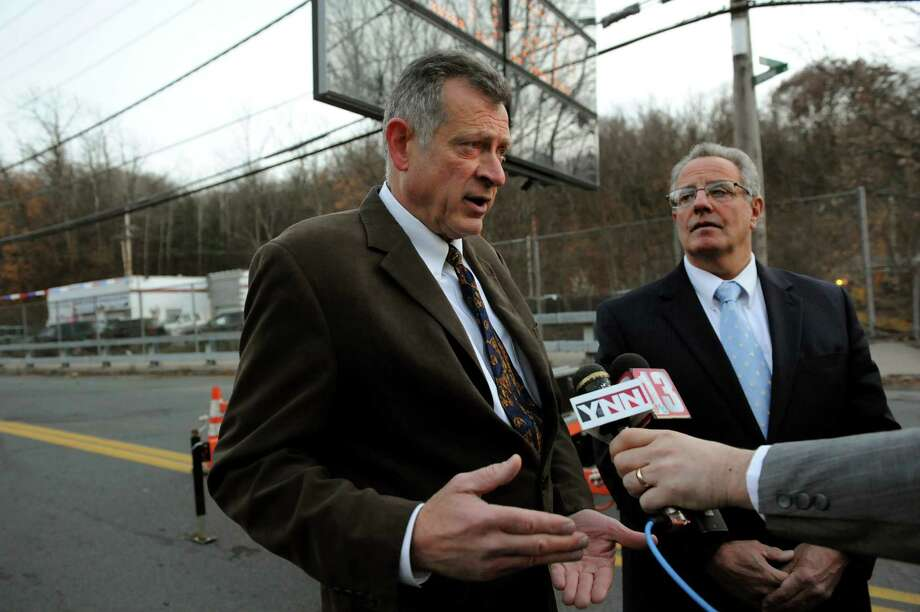 City engineer Russ Reeves, left, and Mayor Lou Rosamilia speak to the media about closing the Spring Avenue Bridge on Friday, Nov. 15, 2013, in Troy, N.Y. The city has determined that the bridge over the Poesten Kill must be closed due to stability issues. (Cindy Schultz / Times Union) Photo: Cindy Schultz / 00024674A