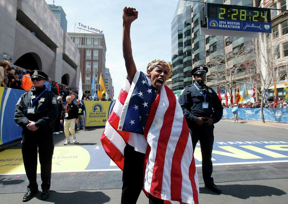 Meb Keflezighi, of San Diego, Calif., celebrates his victory in the 118th Boston Marathon, Monday, April 21, 2014, in Boston.(AP Photo/Elise Amendola) ORG XMIT: BX228 Photo: Elise Amendola / AP