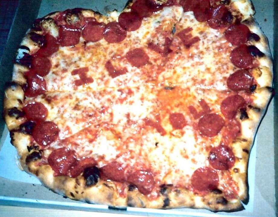 "Jayne Fusaro's favorite Valentine's Day card from her husband Peter was this heart-shaped pizza that says ""I Love You"" — in pepperoni. Photo: Contributed Photo / Greenwich Citizen"