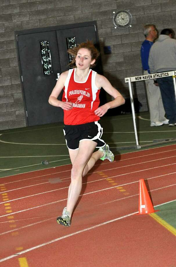 Fairfield Warde's Meg Ryan rounds the corner in the girls 1600 meter during the track meet at Hillhouse Athletic Center in New Haven on Thursday. Photo: Amy Mortensen / Connecticut Post