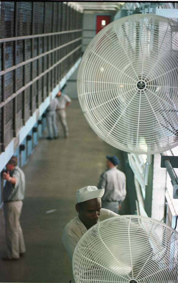 Wall-mounted fans blow a steady breeze in one section of the Wynne unit. Throughout the prison system, two inmates have died from what is believed to be heat-related causes. Photo: Ben Desoto, Houston Chronicle / houston chronicle