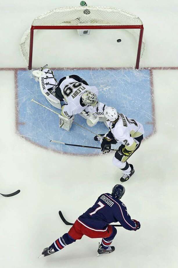 COLUMBUS, OH - APRIL 21:  Jack Johnson #7 of the Columbus Blue Jackets shoots the puck past Matt Niskanen #2 and Marc-Andre Fleury #29 of the Pittsburgh Penguins during the first period in Game Three of the First Round of the 2014 NHL Stanley Cup Playoffs at Nationwide Arena on April 21, 2014 in Columbus, Ohio. Pittsburgh defeated Columbus 4-3. (Photo by Kirk Irwin/Getty Images) ORG XMIT: 485352991 Photo: Kirk Irwin / 2014 Getty Images