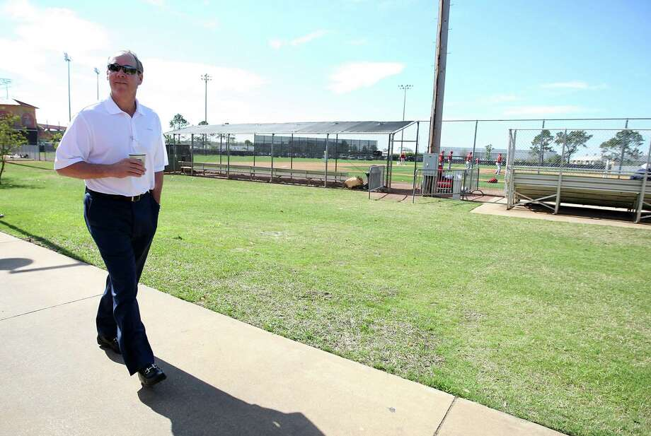Owner Jim Crane strolls through Osceola County Stadium in Kissimmee, Fla. But now the Astros are working on a joint site with the Nats in Palm Beach County. Photo: Karen Warren, Staff / © 2012  Houston Chronicle