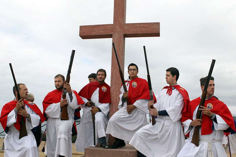 Onward Christian soldiers:Greek Orthodox men lock and load for an Easter   celebration near the Saint Spiridon Church in Cargese, Corsica. Cargese, an old Greek   colony, observes Easter in its Orthodox church with ceremonies punctuated by canticles and   gunshots. Photo: Pascal Pochard Casabianca, AFP/Getty Images