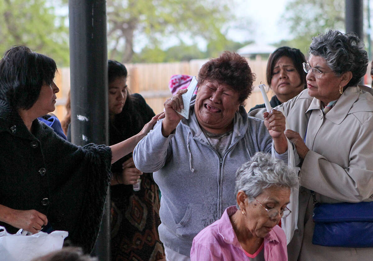 Contreras Elida, center, a resident of Mission Trails Mobile Home Park, 1515 Mission Road, is anguished as she and other residents gather on Wednesday, April 16, 2014, to discuss their options and pray before a City Council meeting the following day concerning a requested zoning change that would allow a local developer to build a 600-unit apartment complex on the site. MARVIN PFEIFFER/ mpfeiffer@express-news.net