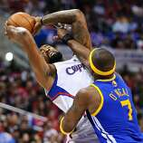 DeAndre Jordan, who was one of seven Clippers to score in double figures, is fouled by Jermaine O'Neal.