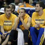 Glum faces on the Warriors' bench.