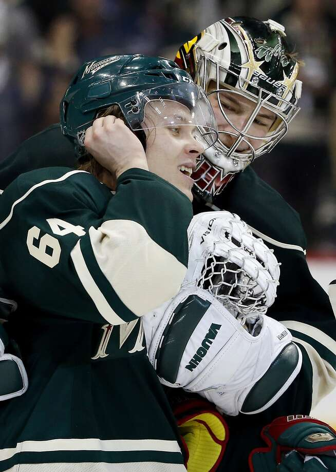 The Wild's Mikael Granlund is congratulated by goalie Darcy Kuemper after scoring in overtime. Photo: Carlos Gonzalez, McClatchy-Tribune News Service