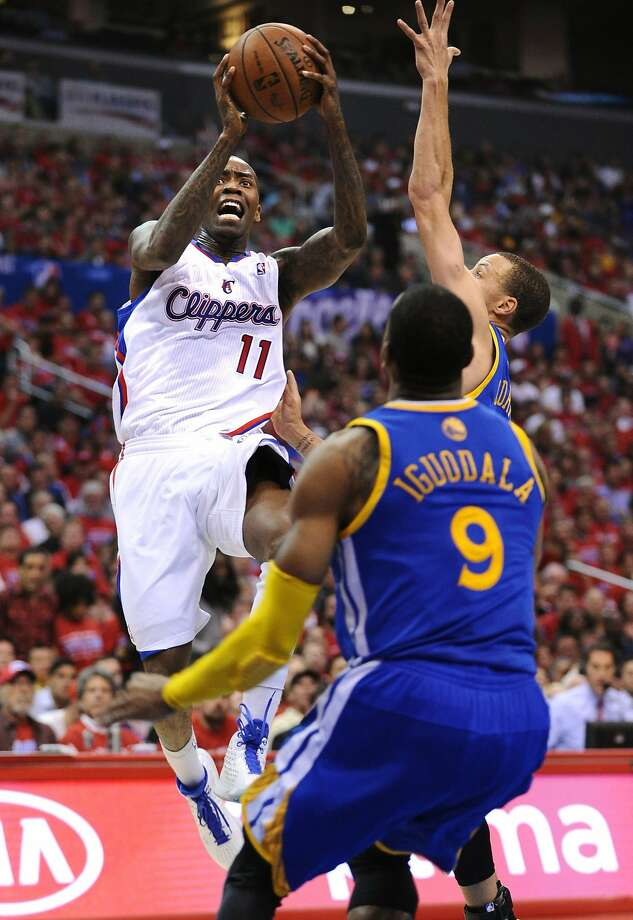 Clippers guard Jamal Crawford drives to the basket against Stephen Curry and Andre Iguodala during Los Angeles' victory. Photo: Wally Skalij, McClatchy-Tribune News Service