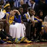 Members of the Golden State Warriors watcher during the second half in Game 2 of an opening-round NBA basketball playoff series loss to against the Los Angeles Clippers in Los Angeles, Monday, April 21, 2014. (AP Photo/Chris Carlson)