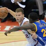 Los Angeles Clippers Blake Griffin protects the ball against Golden State Warriors Draymond Green (R)  during Game Two of their  first-round NBA Western Conference playoff game at the Staples Center in Los Angeles California April 21, 2014.  AFP PHOTO / ROBYN BECKROBYN BECK/AFP/Getty Images